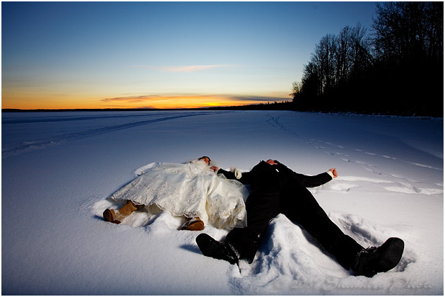 Bride and Groom lying in the snow