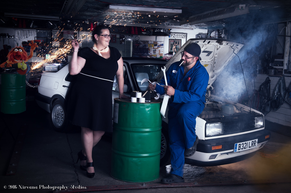 Bride and groom in garage set engagement shoot