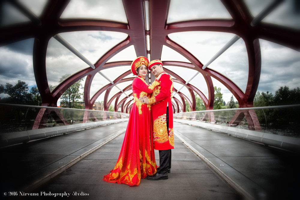 Vietnamese costumed bride and groom on Calgary bridge