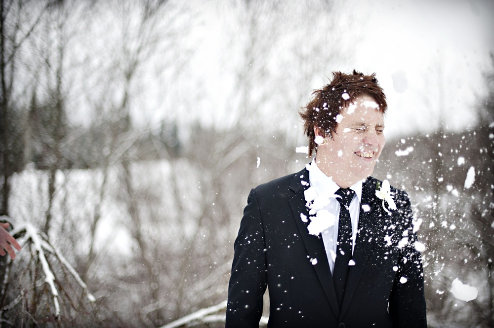 Groom sprinkled by snow