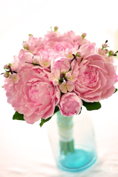 Cherry blossom wedding flower in a vase