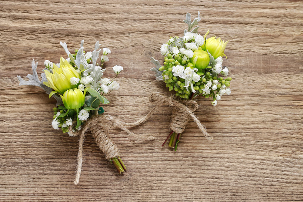 Wearing a wedding boutonniere the right way makes the difference between looking like a movie start or someone who doesn't know what he is doing