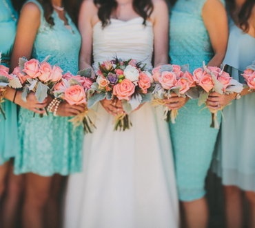 bride and bridesmaid holding floral bouquets