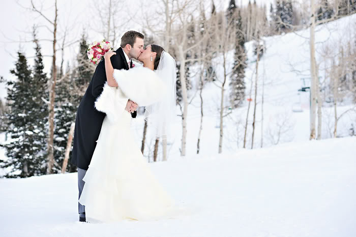 Winter wedding Bride and groom kissing in the snow
