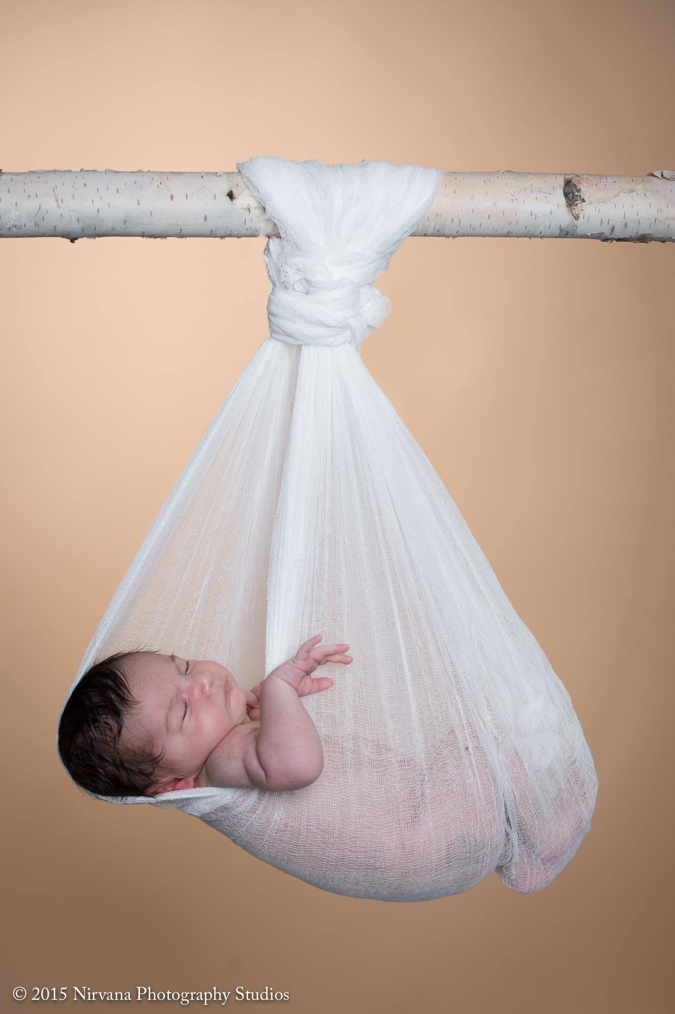 Baby Mohammad sleeping soundly in a white net-cloth swing